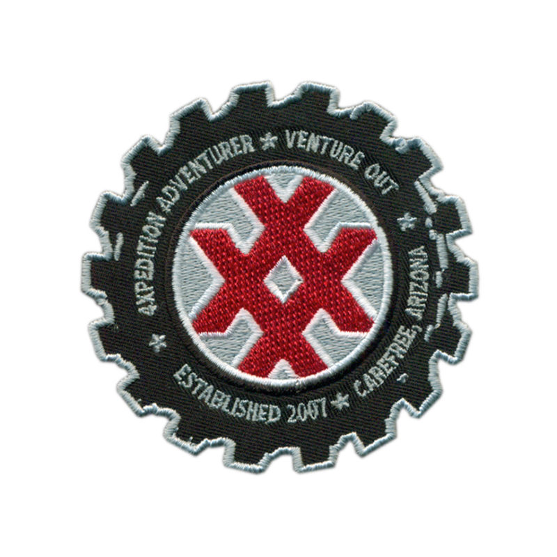 4XPEDITION Crossover Icon embedded in a mud terrain tire graphic. 4XPEDITION Venture Out • Established 2007 • Carefree, Arizona. Get this limited edition patch while supplies last!